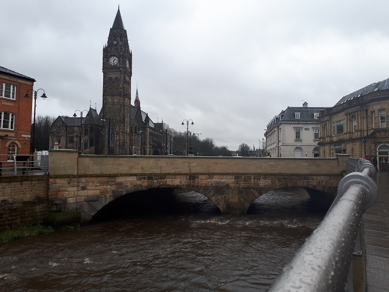 Rochdale Town Hall and the River Roch on a rainy day. March 2nd 2019.