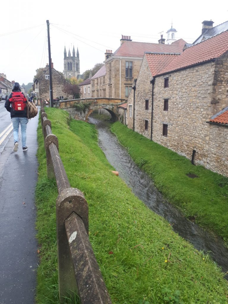 Helmsley on a rainy day in October 2019. Borough Beck running behind the main square.