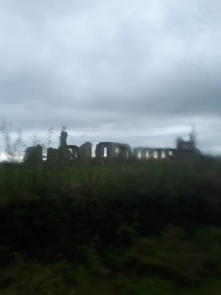 Fuzzy picture of Byland Abbey ruins from the 31x bus from Helmsley to York.