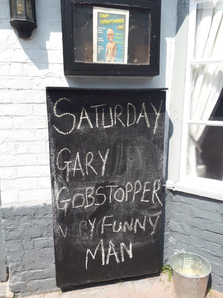 Gary Gobstopper. It says on the sign that he's a very funny man, so it must be true.