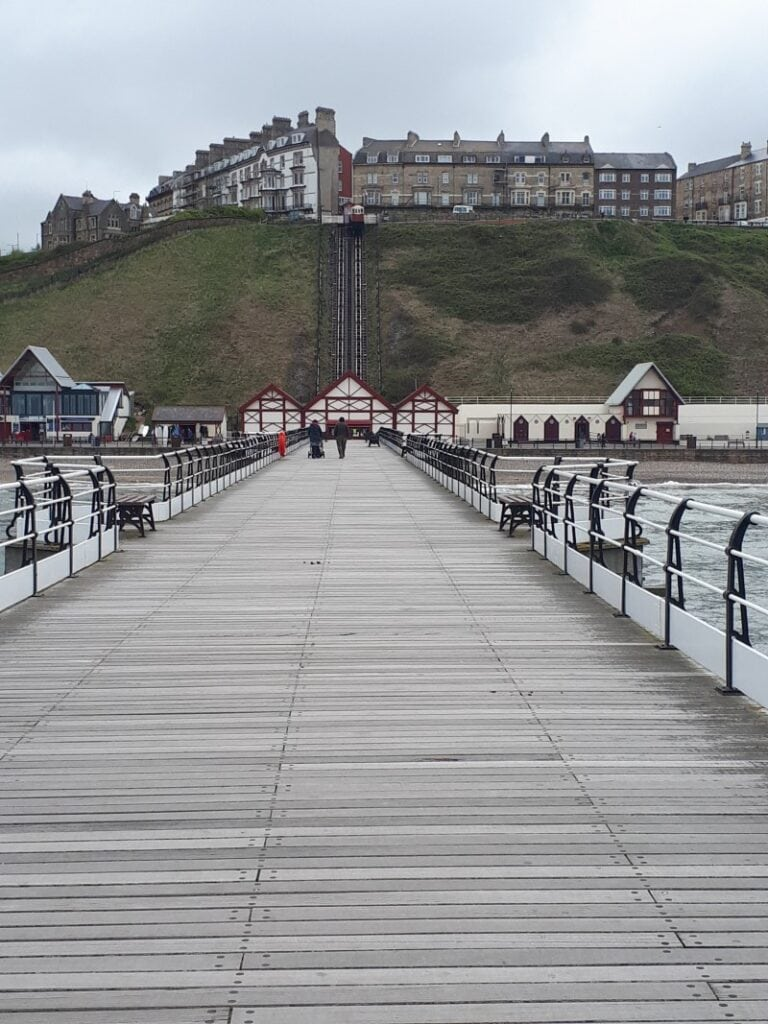Saltburn Pier, looking back towards the town on the cliff above. The tramway can be seen if you squint, too. 2/5/19.