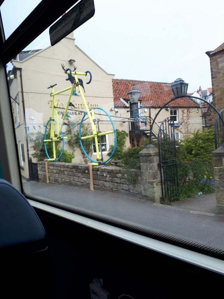 The Hart Inn, Sandsend, with a gigantic yellow Tour de Yorkshire bike outside. Pic taken in a hurry from the X4 bus, 2/5/19.